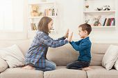Brother And Sister Playing Clapping Hands Together At Home. Children Game, Joint Activities And Inte poster