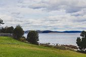 Meadows Next To The Beach In Hobart, Tasmania On An Overcast Stormy Day poster