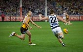 MELBOURNE - SEPTEMBER 9 : Mitch Duncan (R) kicks during Geelong's win over Hawthorn - September 9, 2