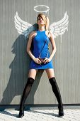 picture of fashionable girl in bue dress with angel wings
