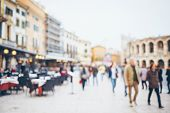 Crowd Of People Walking In The City Square, Blurred Backgound. poster