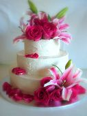 picture of stargazer-lilies  - A wedding cake decorated with buttercream and fresh stargazer lilies and pink roses - JPG