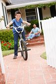 Boy and grandfather at home with bike
