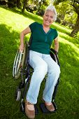 Senior Woman With Wheelchair In Nature