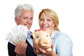 Women Holding Piggy Bank And Euro Money