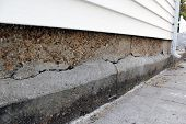 Foundation Damage On A Residential Home Garage poster