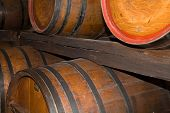 stock photo of wine cellar  - Oak wine barrels in an ancient wine cellar - JPG