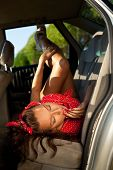 Young sexy woman lay in car - pinup style