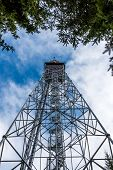 Look To Transmitter Telecommunication Tower From The Ground. Gsm And Television Signal, Touristic Lo poster