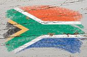 Flag Of South Africa On Grunge Wooden Texture Painted With Chalk