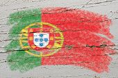 Flag Of Portugal On Grunge Wooden Texture Painted With Chalk