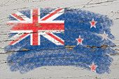 Flag Of New Zealand On Grunge Wooden Texture Painted With Chalk