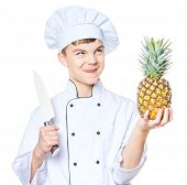Handsome Teen Boy Wearing Chef Uniform Holding Ananas And Big Knife. Portrait Of Cute Male Child Coo poster