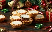 British Christmas Iced Mince Pies With Decoration, Gifts, Green Tree Branch On Wooden Rustic Table poster