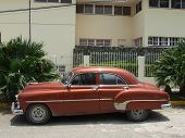 stock photo of side view  - Side view of an old American car stopped in a road in Havana Cuba - JPG