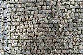 European Granite Cobblestone Pavement With Different Stones. Gray Stone Background, Textured Pedestr poster