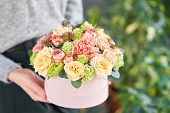 European Floral Shop. Floral Bunch In Round Box. Bouquet Of Beautiful Mixed Flowers In Woman Hand. E poster