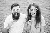 Funny And Playful. Funny Couple Looking Through Prop Glasses On Green Grass. Bearded Man And Sexy Wo poster