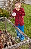 Boy Makes Mistake Feeding Chickens