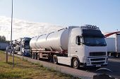 Trucks Transporting Various Goods. Photo Shows A Tanker And A Truck For Transporting Passenger Cars. poster