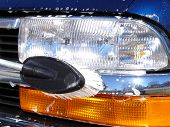 picture of car wash  - a headlight of a car being washed - JPG