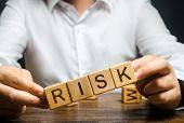 The Man Carelessly Raises The Word Risk. High Risks In Business, Fragile Balance And Insecurity. Cau poster