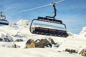Ski Lift Ropeway On Hilghland Alpine Mountain Winter Resort On Bright Sunny Day. Ski Chairlift Cable poster