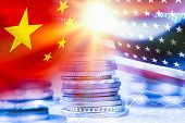 Usa And China Flag On Coins Stacking .it Is Symbol Of Economic Tariffs Trade War And Tax Barrier Bet poster