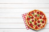 Hot Delicious Pepperoni Pizza On White Wooden Table, Top View. Space For Text poster