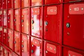 Close Up Of A Row Of Red Postboxes poster