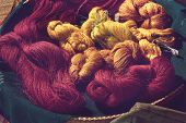 Close Up Of Red And Yellow Colour Tie Dye Silk Yarn For Weaving, Thai Mudmee Fabric, Silk Yarn Dyed  poster