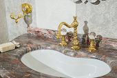 Sink Made Of Expensive Marble Stone. Vintage Design Of Faucet And Taps, In Gold And Glass Handles poster