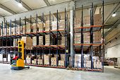 stock photo of forklift  - Yellow fork lifter work in big warehouse - JPG