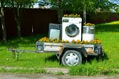 Trailer With Home Appliances. Tv And Washing Machine