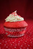 stock photo of red velvet cake  - Red velvet cupcake on a red background - JPG