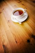 Cup of tea on wooden background with copy space