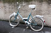bike in snow near wall