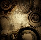 stock photo of interlocking  - Closeup of gears and grunge background - JPG