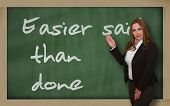 Teacher Showing Easier Said Than Done On Blackboard