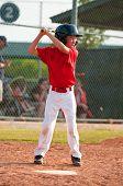 stock photo of little-league  - Little league baseball player at bat waiting to swing - JPG