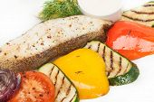 Hot Roast Fish With Garnish Of Grilled Color Fresh Vegetable