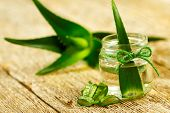 stock photo of jar jelly  - Extract of aorganic aloe vera gel on wooden background - JPG