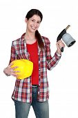 craftswoman holding a welding torch