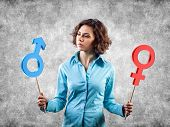 stock photo of hetero  - Two symbols of a different gender in hands of the girl - JPG