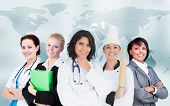 Women in different careers smiling together on world map background