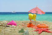 Girl Under The Sun Umbrella On The Beach