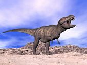stock photo of tyrannosaurus  - Agressive tyrannosaurus dinosaur in the desert cloudy day with its mouth open showing his teeth - JPG