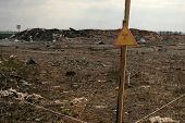 pic of fukushima  - sign warning about the zone contaminated by radiation on the background of the contaminated soil - JPG