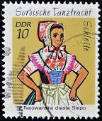 EAST GERMANY- CIRCA 1971: stamp printed in Germany shows Dance Costume Schleife