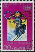 stamp printed in Korea dedicated to Winter Olympic Games Sapporo-Innsbruck shows woman skiier